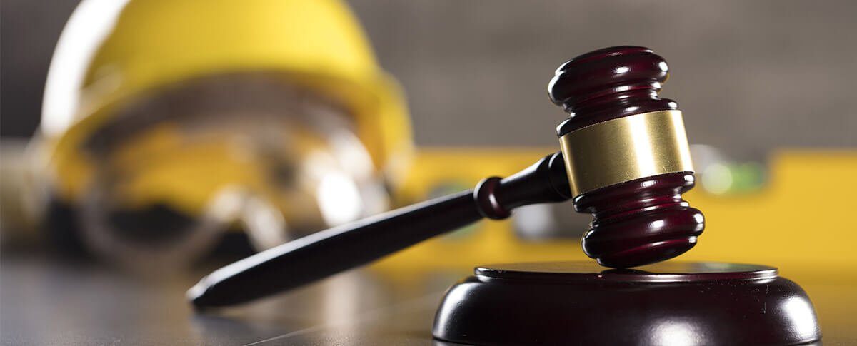 Image of judge gavel with construction hat